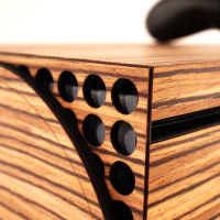 Detail of bottom cover, Toast wood cover for Xbox Series X in zebrawood.