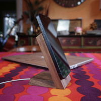 Toast stand for Apple MageSafe Charger in walnut.