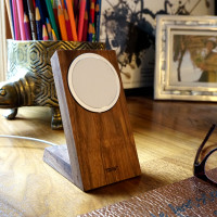 Toast wood stand for Apple MageSafe Charger in walnut.