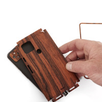 Installation detail of Toast wood cover for Pixel 5.