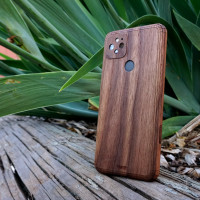 Real wood case / cover for Google Pixel 5 in walnut, outdoors.