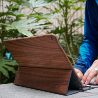 Toast wood iPad Pro 12.9 cover in Walnut, working outside.