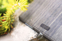 Toast wood iPad cover in ebony, lifestyle.