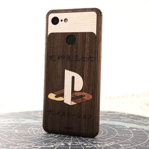 PlayStation inlay design in ebony, ash, bamboo and walnut