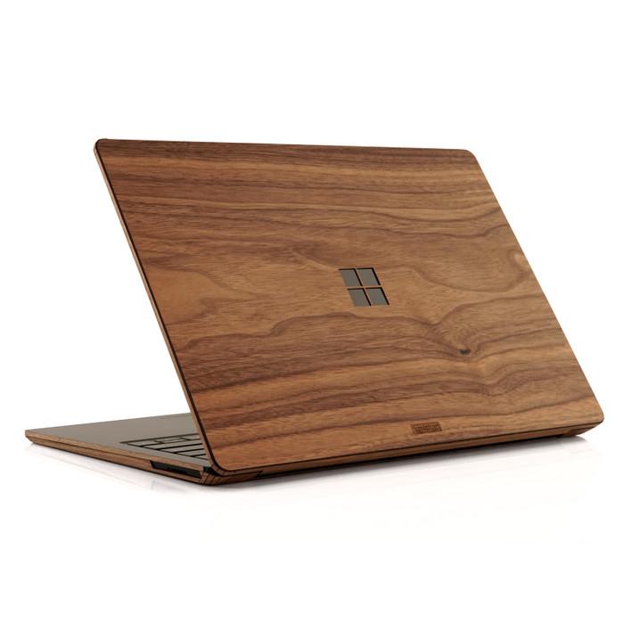 Surface Laptop in walnut with windows cutout.