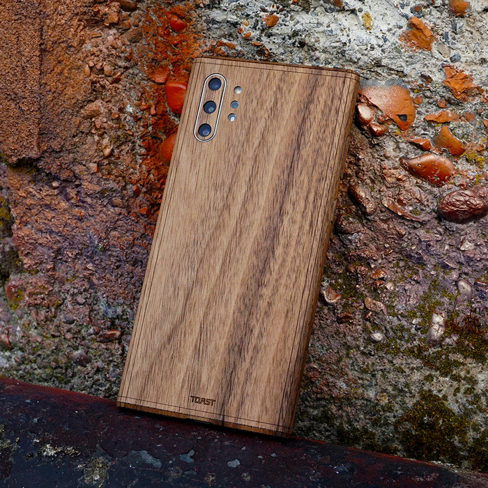 Toast wood cover for Samsung Galaxy Note 10+ in walnut, lifestyle.