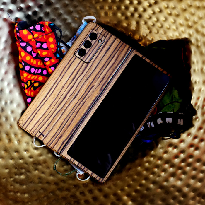 Samsung Galaxy Fold 2 wood cover by Toast.  Lifestyle in zebrawood.