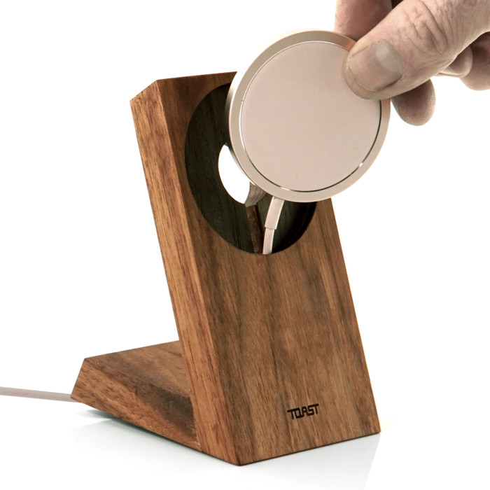 Toast stand for Apple MageSafe Charger in walnut.  Hidden magnets snap the Apple Charger into place.