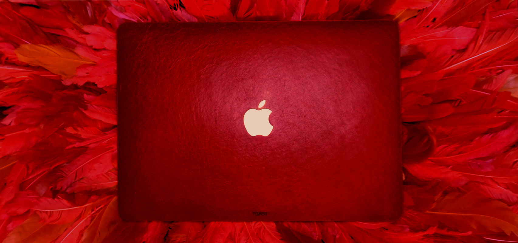 red-leather-macbook-air-2018-on-red-feathers-banner-for-web.jpg