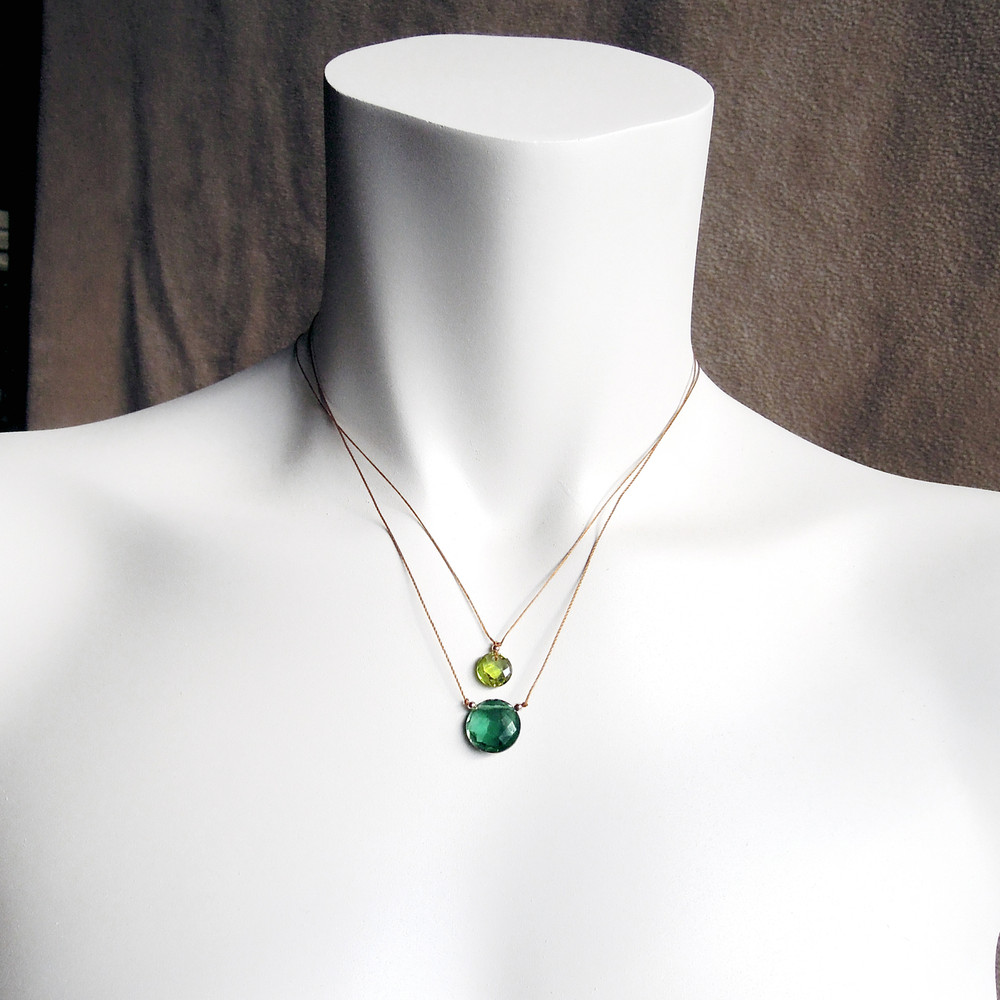 "(the moss aquamarine is the same size as the bottom stone on the model - the top stone is an 8mm ""cutie pie"")"