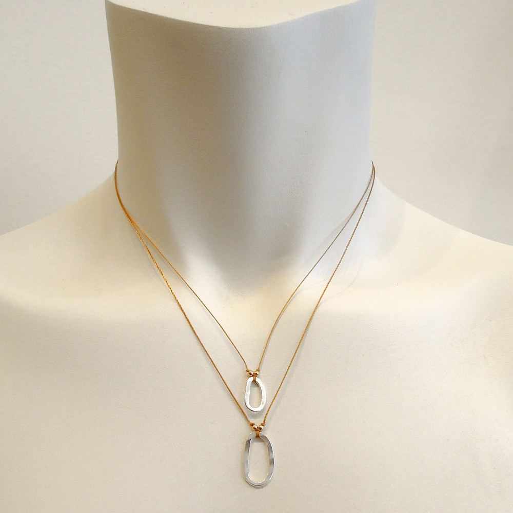 pic of model sporting necklaces  - this size is on the bottom - for size reference only.