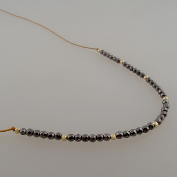 "4"" Halo of micro faceted 2mm (TINY!) hematite on our golden brown bonded microfiber....14kt gold fill accents"