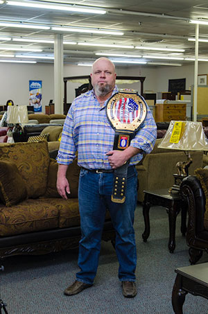 chris-with-belt-trophy.jpg