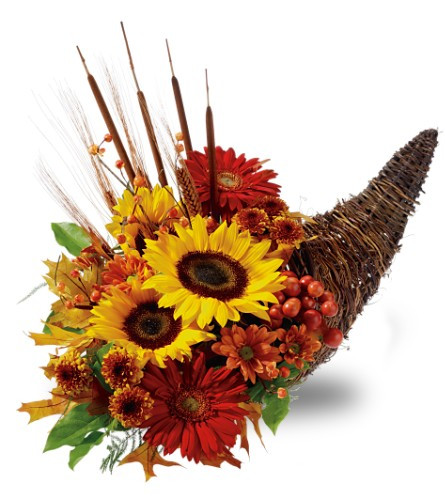 Country Cornucopia filled with vibrant sunny yellow sunflowers, red gerbera daisies wheat and cattails.