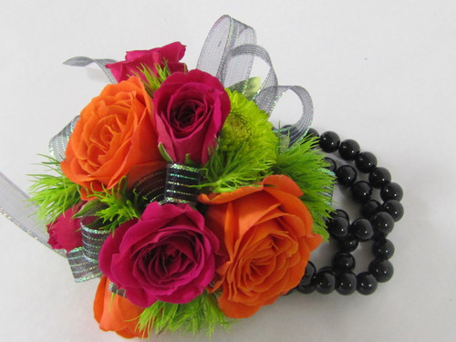 Chic and Stunning. Delicate orange and hot pink spray roses designed on a Black Beaded Bracelet. We can custom design to match your style of dress. An exclusive by Chappells Florist