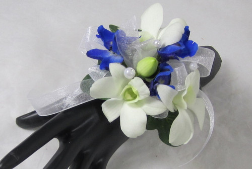 Bright Night Blue. This corsage is designed with white orchids and accenting blue flowers. A Chappell's exclusive.