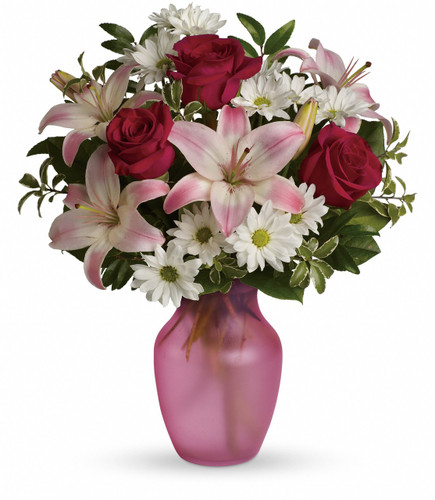 Includes red roses, pink asiatic lilies, white daisy chrysanthemums and fresh greenery. Delivered in a glass rose vase.