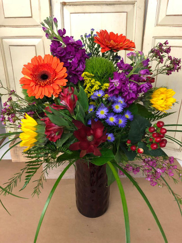 Beautiful assortment of fall toned flowers. Gerbera daisies, Sunflowers, Stock are just a few to name. Brighten someone's day with this bouquet