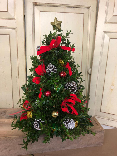 Hand made Boxwood tree decorated with bows, pinecones, millimeter balls , shiny packages. approximately 18inches tall.  Perfect for any table upgrade and add lights.
