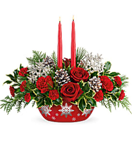 This bouquet featured red roses, red carnations, miniature red carnations, flat cedar, variegated holly, white pine, and two red candles. Delivered in Teleflora's Winter's Eve Dish.
