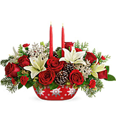 This bouquet features red roses, white lilies, miniature red carnations, seeded eucalyptus, and two red candles. Delivered in Teleflora's Winter's Eve Dish.