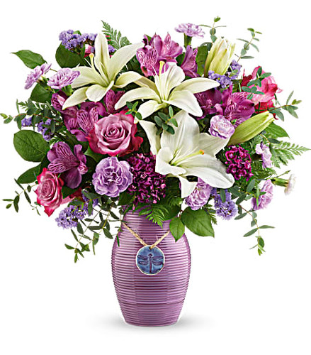 Lush and lovely, this majestic rose and lily bouquet, presented in an artisanal ceramic vase with charming dragonfly pendant is a dreamy reminder of your love on any day and beyond!