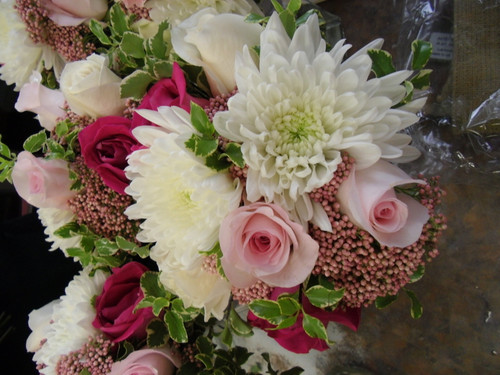 Beautiful Bridal Bouquet of Roses and Cremons with a nice touch of Rice flower and foilage.
