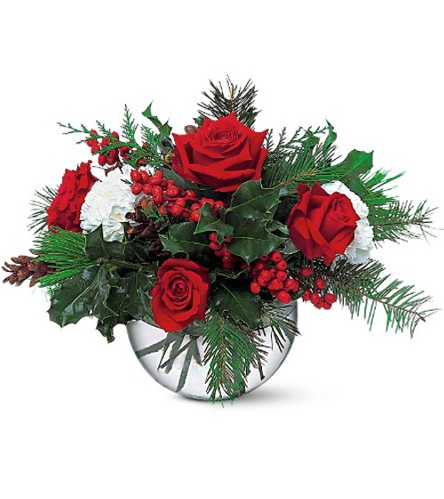 Beautiful bowl of Red roses, white carnations, and the scent of winter greens through out.
