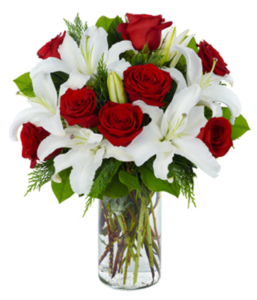 What a perfect present! Stunning white lilies and gorgeous red roses are a safe bet to bring Valentine's Day to life.