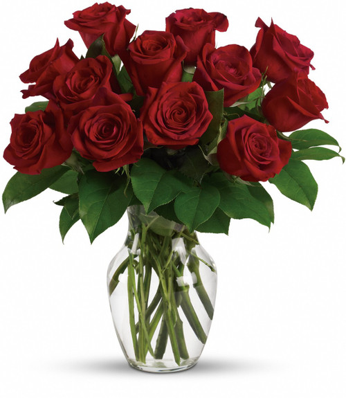 This romantic bouquet includes one dozen red roses accented with lush greenery. Delivered in a clear glass rose