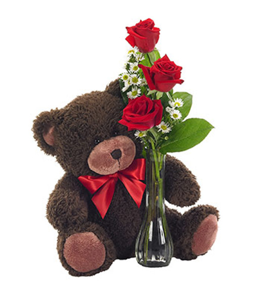 A cute Teddy Bear holding on to Three roses.