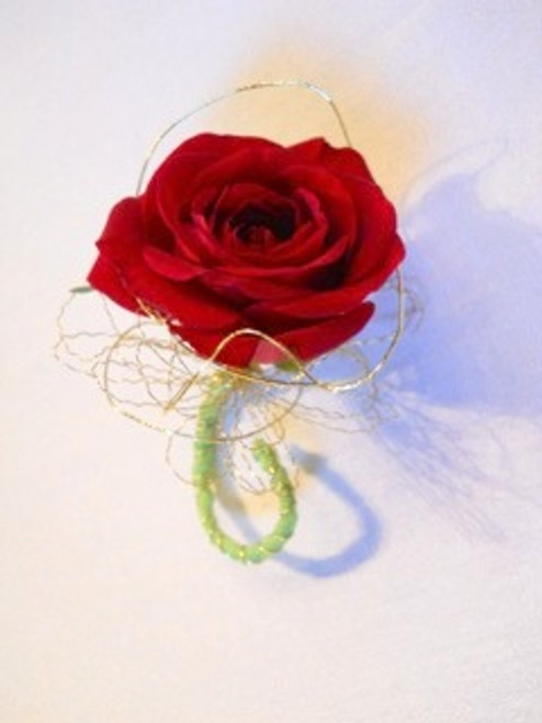 Big Night Red. A simple red rose surrounded by gold wire--A Chappell's exclusive.