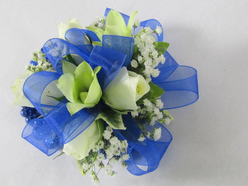 Beautiful Blue corsage designed with white orchids and white miniature spray roses with a touch of babies breath. Adorn her evening with this exclusive design by Chappells Florist.