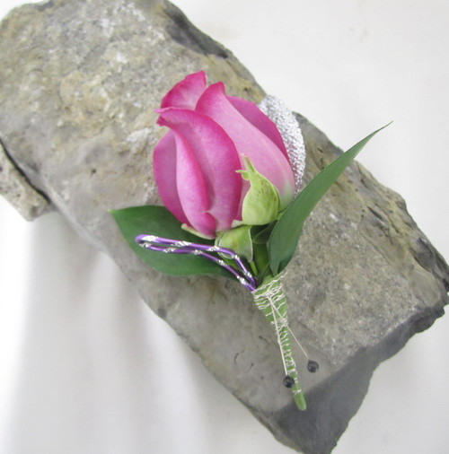 Silver and Shine with this purple rose with silver wire wrapped stems. Available in many color choices. Call us today and we can help you make the right choice.  Chappell's Florist 802-658-4733