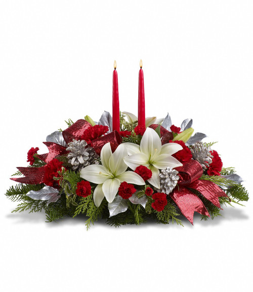Shiny and bright! Holiday celebrations shine with this lush arrangement of snow white lilies and red carnations beautifully arranged with fresh holiday greens, silver pine cones and glistening red ribbon.