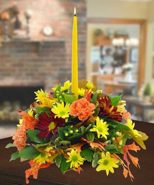 Autumn centerpiece with a candle to light up your Dinner Table and give Thanks.