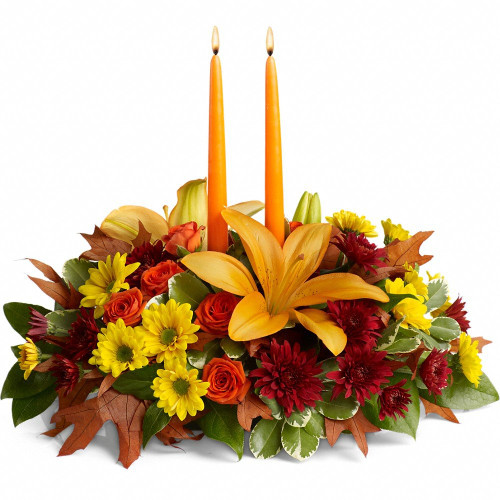 Lovely Fall Centerpiece with 2 Candles to Glow on a Crisp Fall Dinner with Family and Friends designed with Vibrant fall Tones of Daisies, Lilies, and Roses.