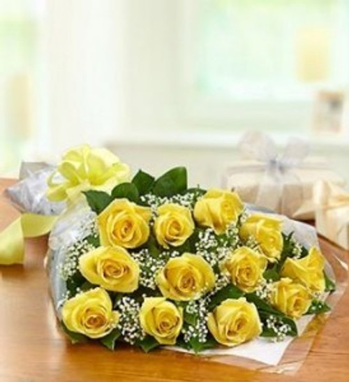 dozen yellow roses wrapped presentation