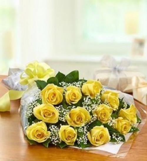 dozen yellow roses wrapped presentation