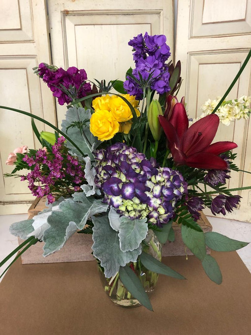Chappell's Creation of a nice mix of garden flowers, Hydrangea, Roses, Stock, Dusty Miller are just a few to name. The designers are hot this Fall Season