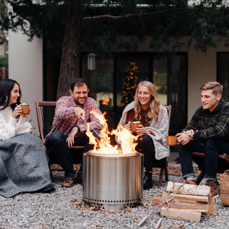 Sit around the Solo Stove Bonfire Fire Pit with friends