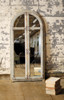 MIRROR WITH ARCHED WOODEN FRAME