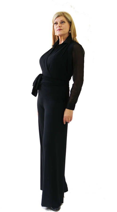Black halter wrap shown wide pant and  black sheer blouse.