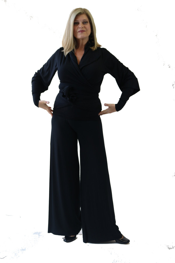 The classic wrap jacket shown with wide leg pants and arm gloves.