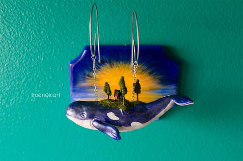 Blue sky whale sculpture