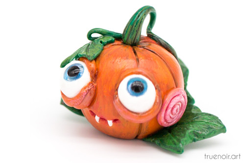 Cunning Pumpkin by Oksana Ossipov Polymer clay figurine, 1.5 inch. Side view.