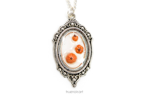 Triple Pumpkin Cameo, Floating Fruits series by Oksana Ossipov. Original resin and polymer clay jewelry, full view.