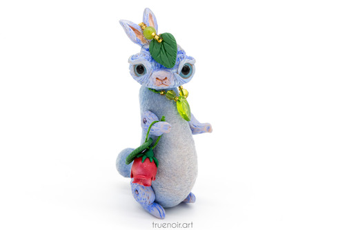 Miss Blue - Bunny with Accessories, OOAK art doll by Oksana Ossipov Mixed media, 2021. Front view with rose and leaf on her head as well as left necklace.