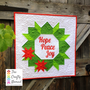 Christmas Joy Wreath Mini Quilt and Cushion Pattern by The Crafty Nomad Mini Quilt