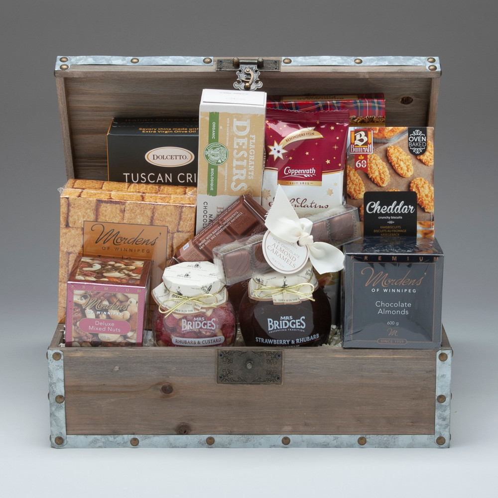 This gorgeous gift comes arranged in a lovely wooden trunk, and is filled with our very finest selection of traditional gourmet foods: jam, cookies & crackers, nuts & sweets. It is a classic selection for those who prefer familiar tastes, and is well suited for a group to share. We think it is perfect for friends, family & clients who have discerning tastes.  *Please note we have limited trunks available, and will be substituting a gorgeous high-quality KUBU natural grey rattan basket. If you have questions, please call our office at 204-791-5709